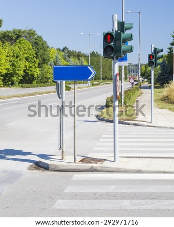 red traffic lights road - blue sign - stock photo