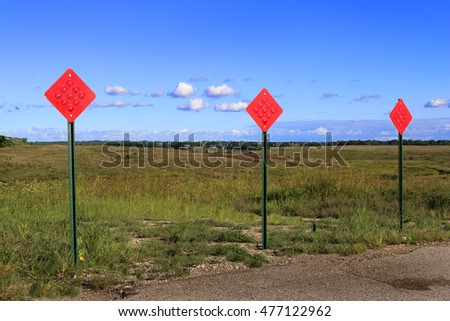 red traffic reflector signs background