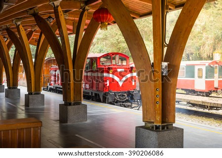 Red train under blue sky on railway forest in Alishan National Scenic Area, Taiwan. - stock photo
