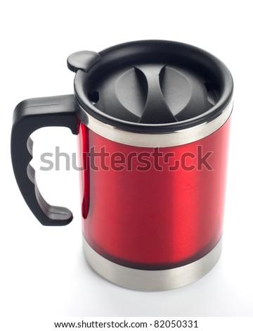 Red travel mug isolated on white - stock photo