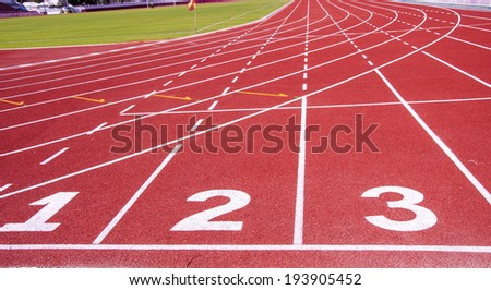 Red treadmill at the stadium with the numbering from one to three. - stock photo