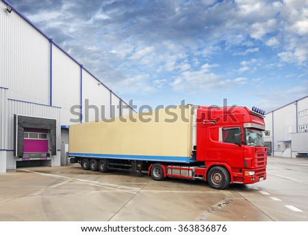 red truck in the warehouse - stock photo