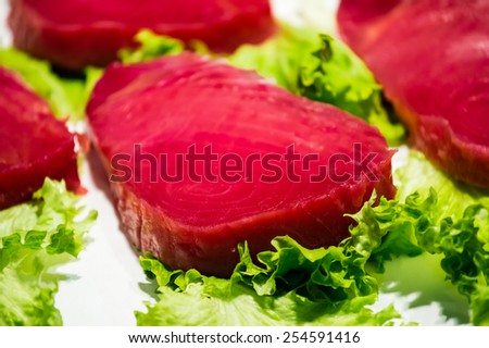 Red tuna steak with lettuce - stock photo