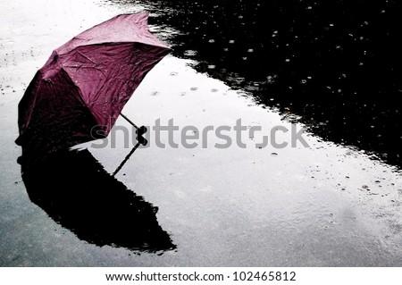 Red Umbrella in Rain - stock photo