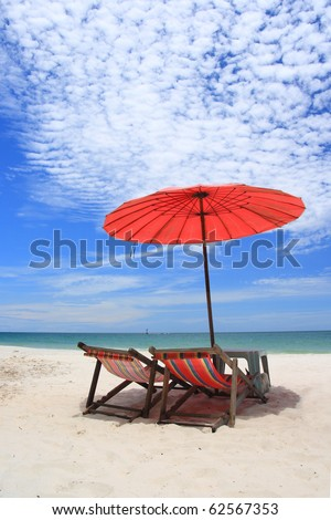 Red umbrella on the beach beautiful.