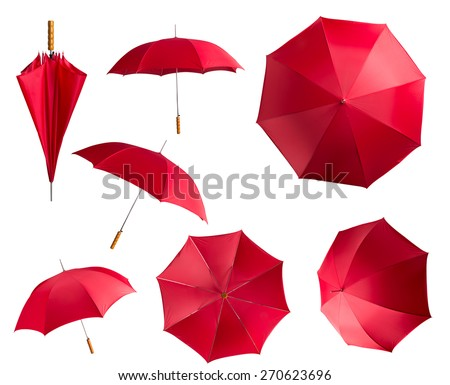 Red umbrellas on white - stock photo
