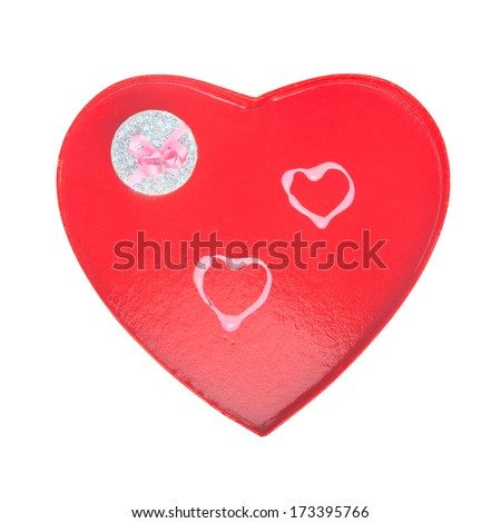 Red Valentines cardboard heart with two pink lipstick-drawn hearts and a silver gift box; isolated on white
