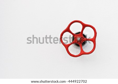 Red valve on white background. Detail on a ship. - stock photo