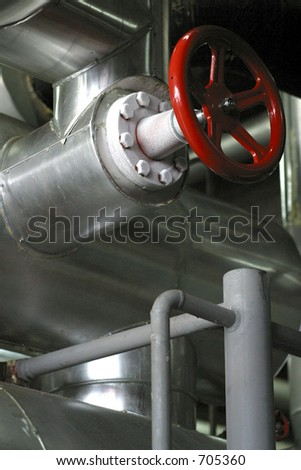 red valve with ice and stainless steel pipes - stock photo