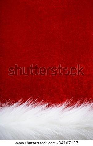 Red velvet and white fur. Part of Santa' s clothing. - stock photo
