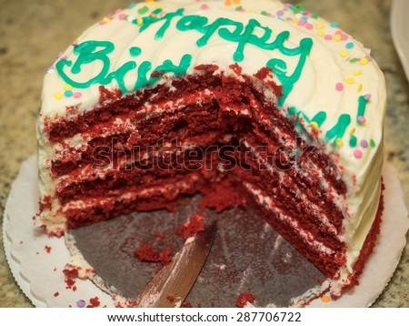 Red velvet cake is a cake with either a dark red, bright red or red-brown color. It's traditionally prepared as a layer cake topped with cream cheese or cooked roux icing. - stock photo