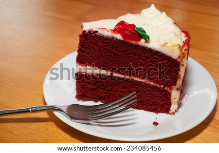 Red velvet cake on a white plate with a fork  - stock photo