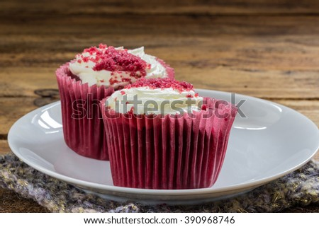 Red velvet cupcake on a wooden table