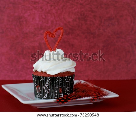 Red velvet cupcake with vanilla frosting - stock photo