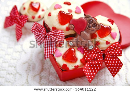 Red velvet cupcakes decorated with hearts for Valentines day - stock photo