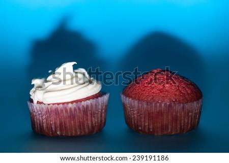 Red velvet cupcakes on blue background - stock photo