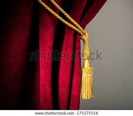 Red velvet curtain with tassel. Close up - stock photo