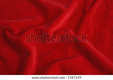 Red velvet fabric. Soft texture cloth. Look at my gallery for more backgrounds and textures - stock photo