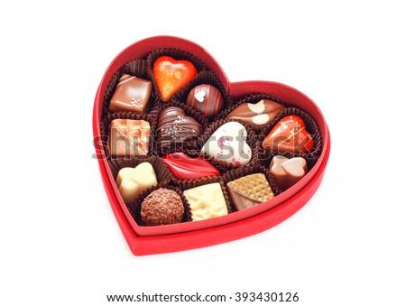 Red velvet, heart shaped box of chocolates. Shot on white background. - stock photo