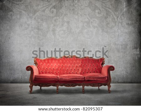 Red velvet sofa - stock photo