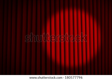 Red Velvet Stage Curtains with Round Spotlight. - stock photo