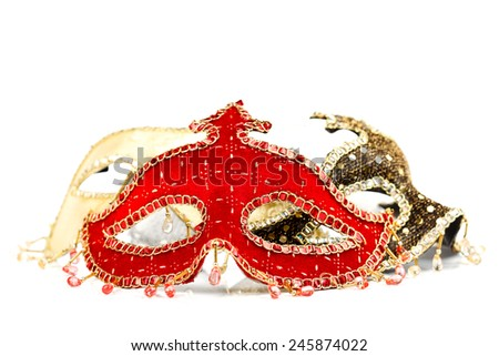 Red Venice mask with other masks in the background on white - stock photo