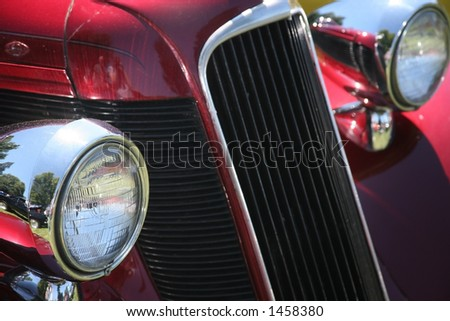 Red Vintage Car with Chrome Headlights and Grill - stock photo