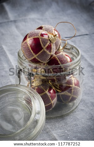 Red vintage christmas balls in the jar