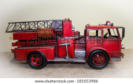 Red vintage firetruck toy - stock photo