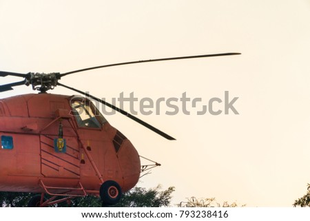red vintage helicopter