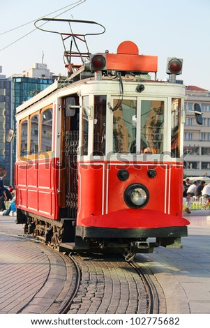 Red vintage tram on Taksim square in Istanbul, Turkey - stock photo