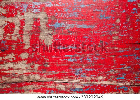 Red vintage wooden table background with chipped paint - stock photo