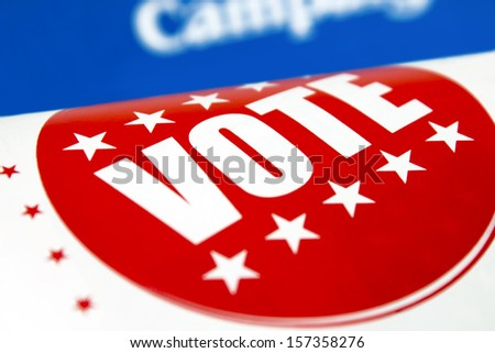 Red Vote sticker printed in a political newspaper flyer
