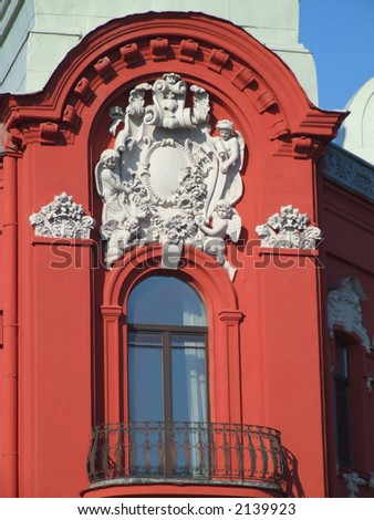 Red wall of a historic building and a balcony. - stock photo