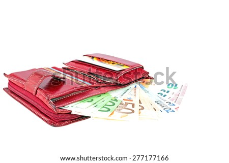 Red wallet full with euro banknotes on a white background. - stock photo