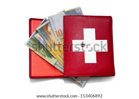 Red wallet with swiss franc banknotes - stock photo