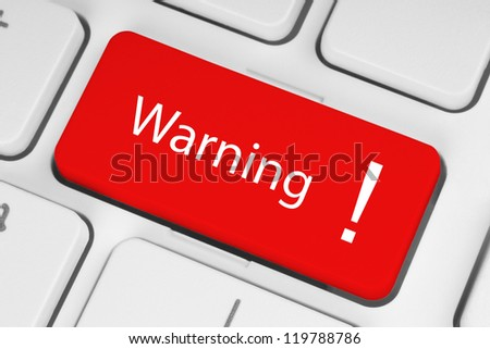 Red warning button on the keyboard - stock photo