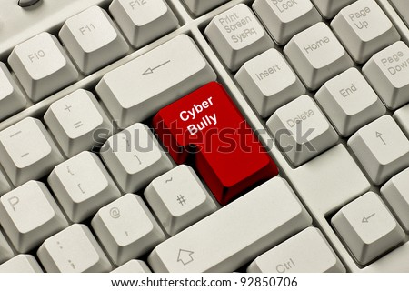 Red warning, enter key on computer keyboard labelled Cyber Bully - stock photo