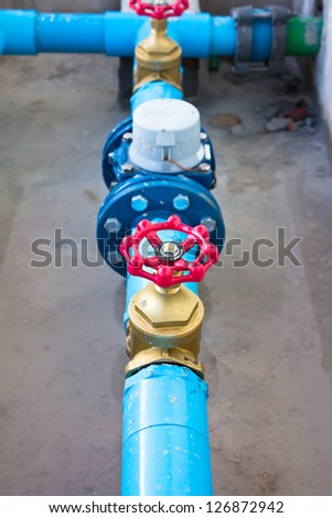Red water valve. - stock photo