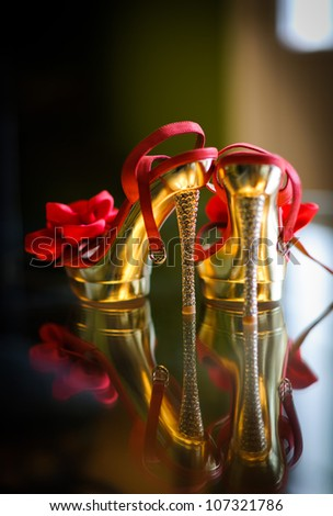 Red wedding shoes - stock photo