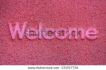 Red welcome carpet, welcome doormat carpet - stock photo