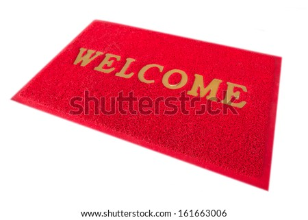 Red welcome mat isolated on a white background.