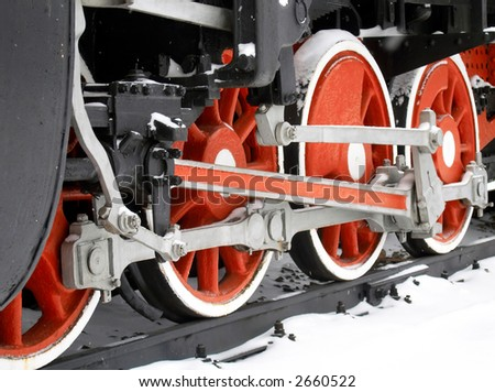 Red wheels of old locomotive