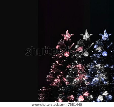red white and blue christmas trees on black background