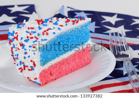 Red white and blue layer cake with sprinkles