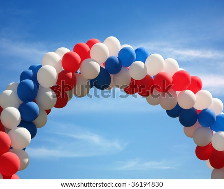 Red white and blue patriotic balloon arch background - stock photo