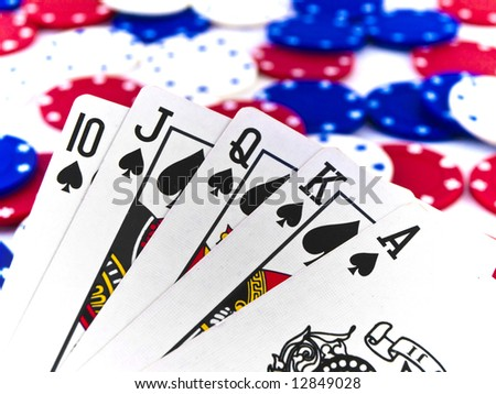 Red White and Blue Poker Chips and Royal Flush on White Background - stock photo