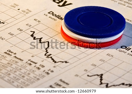 Red, white and blue poker chips over graph of  sinking dollar value - stock photo