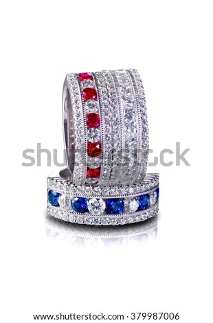Red White and Blue Set of Diamond and Gemstone rings Stacked ruby and sapphire. Isolated on white background - stock photo