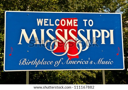 Red, white, and blue sign to welcome travelers to Mississippi - Birthplace of America's Music - stock photo